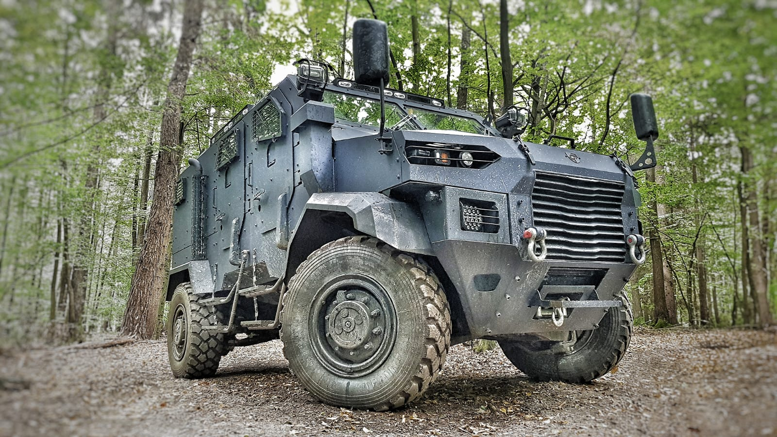 DefTech Armored vehicle HRON parked in the forest.